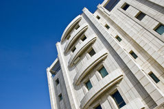 Building. Modern building on a bright blue sky Royalty Free Stock Photo