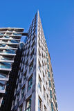 Building. Modern triangle building on a bright blue sky Royalty Free Stock Photos