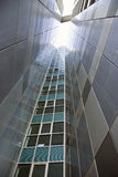 Building. Modern triangle building on a bright blue sky Stock Photo