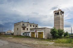 Building is abandoned firehouse. YUBILEYNY, PERM KRAI, RUSSIA - JULY 12, 2016:  building is abandoned firehouse in the summer cloudy day Stock Images