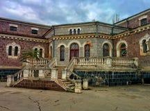 Building of abandoned hospital. Porch of nineteenth century hospital Stock Photo