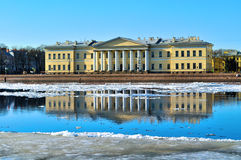 The building of the Academy of Sciences across the Neva river in St Petersburg, Russia. Royalty Free Stock Images