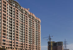 Building against the sky, taps and electric line Royalty Free Stock Photo