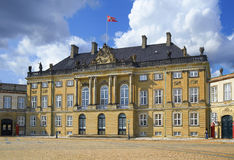The building of Amalienburg with raised standart over it. Royalty Free Stock Photography