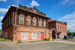 Building of the ancient merchant estate of Stolbov in the sunny summer day. Myshkin. MYSHKIN, RUSSIA - JULY 13, 2016: Building of the ancient merchant estate of Stock Images
