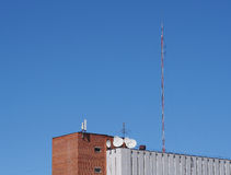 Building with antennas and satellite dish Royalty Free Stock Image