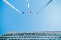 Building, arc architecture and sky and flags. Building and arc architecture in Rome in EUR block, columns Stock Photos