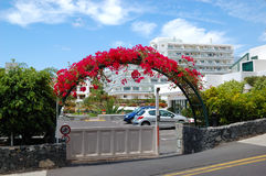 Building and arc with flowers of luxury hotel. Tenerife island, Spain Royalty Free Stock Images
