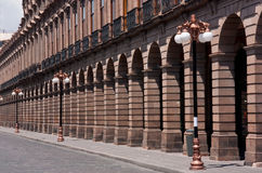 Building arcade with columns  and luminaires San Luis Potosia. Building arcade with columns and luminaires in perspective San Luis Potosi Mexico Stock Image