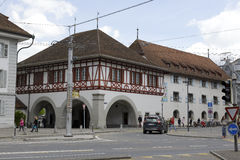 Building with arcades in Lucerne. LUCERNE, SWITZERLAND - MAY 04, 2016: A Building with arcades under which the passage leads to Spreuer Bridge. Ancient armory of Stock Photo