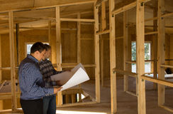 Building Architects Looking at Blueprint Stock Photos