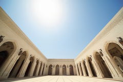 Building with arcs inside Grand Mosque in Oman. Stock Photos