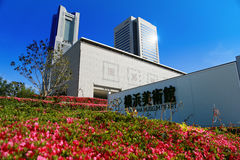 Building of art museum in Japan Yokohama. Building of the Yokohama Museum of Art in Japan Yokohama with fine weather and flowers Royalty Free Stock Photo