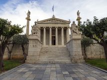 The building of the Athens Academy a marble column with a sculptures of Apollo and Athena, Socrates and Plato against a with cloud royalty free stock photo