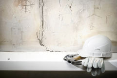 Building background. Building helmet, protective gloves, hammer, adjustable spanner.Building background Royalty Free Stock Images