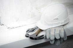 Building background. Building helmet, protective gloves, hammer, adjustable spanner.Building background Royalty Free Stock Image