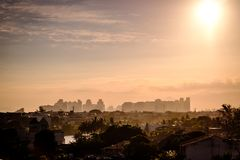 Building in Barra da Tijuca seen from above with houses on the hill during sunset, golden light. Barra da Tijuca, Rio de Janeiro royalty free stock photo