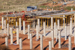 Building Basement Floor Columns. Buiding construction site first floor basement concrete steel columns and floor supports structure steel materials for new Stock Photos