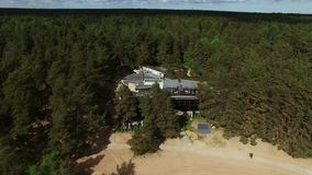 Building on a beach aerial. Shot stock footage