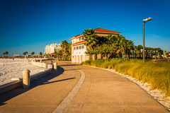Building and the beach along a path in Clearwater Beach, Florida Royalty Free Stock Photography