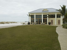 Building on the beach with a lawn and walkway Stock Image