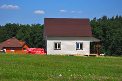 Building beautiful house  with siding walls and roofing  with as Royalty Free Stock Images