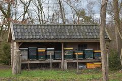 Building with beehives in a grass field 2. A building with beehives in a grass field stock photos