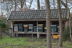 Building with beehives in a grass field 3. A building with beehives in a grass field royalty free stock images