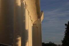Building behind the twilight. Sturdy building in the afternoon Royalty Free Stock Image