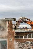 Building Being Demolished. Wall of a building being knocked down royalty free stock photos