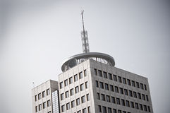 Building with big aerial on the roof Stock Images