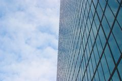 Building and big sky with clouds. Tall building with a big area on the left for text, headline, or caption Royalty Free Stock Image