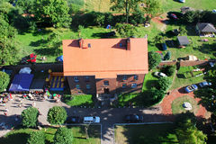 Building a bird's eye. Red brick building covered with red tiles aerial view Stock Photos