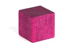 Building block. A pink colored building block stock image