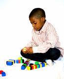 Building Blocks. Young boy with building blocks royalty free stock photos