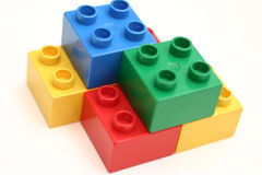 Building Blocks. Colorful building blocks stacked on top of one another Royalty Free Stock Photo