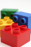 Building Blocks. Colorful to building blocks with red in focus Royalty Free Stock Image