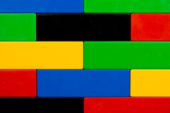 Building blocks. Closeup of black, yellow, blue, green and red building blocks for background Royalty Free Stock Images