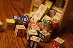 Building Blocks. A child's building blocks spilling out of a box onto a table Royalty Free Stock Photo