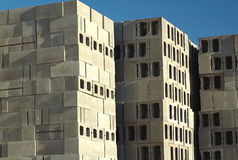 Building Blocks. Stacks of concrete building blocks against a deep blue sky Stock Image