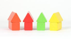 Building blocks. A row of houses from building blocks royalty free stock images
