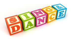 Building blocks. Alphabet building blocks that spelling the word sing and dance Stock Photography