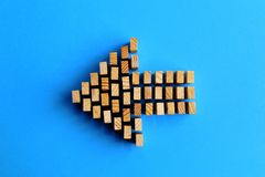 Building blocks arrow symbol isolated on a blue Royalty Free Stock Images