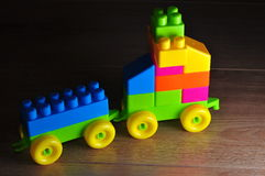 Building blocks car. Car made of color building blocks on the wooden floor Stock Photo