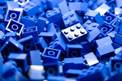 Building blocks with focus and highlight on one selected block with available light. A pile of building blocks with focus and lighting on one single block Stock Images