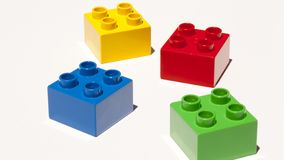 Building blocks isolated. Lego building blocks isolated on white. Four colors - yellow, red, blue and green stock image