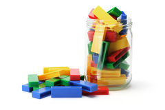 Building Blocks and Jar. On White Background Stock Images