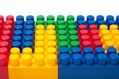 Building blocks. Plastic construction toy isolated on white background royalty free stock photos