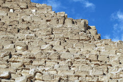 Building Blocks of Pyramids. A closeup showing the blocks which form the pyramids of Giza show that the structure is now smooth as seen from afar stock images