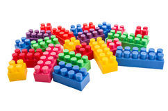 Building blocks scattered on a white background Stock Photo